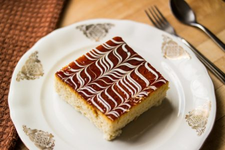 three milk cake, trilece called in turkish, on a white plate with golden eastern ornaments